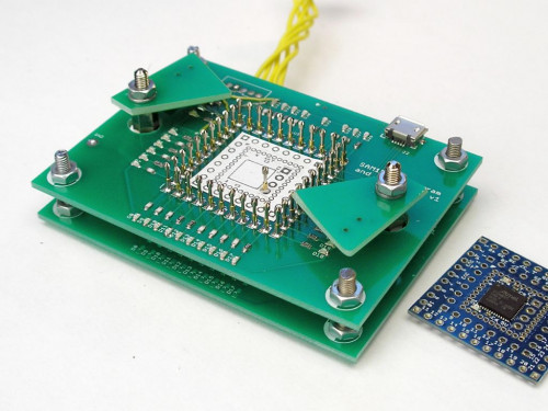 Simple test fixture for PCB probe testing and programming