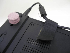 Laptop power cord strain relief with Velcro strap